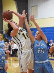 Lourdes' Abby Weeks, left, goes for a shot as Suffern's