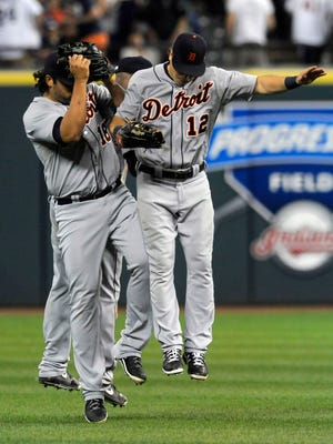 Tigers outfielders Andy Dirks (right), Austin Jackson (back) and Matt Tuiasosopo bump in celebration after a 10-3 win Thursday vs. the Indians.