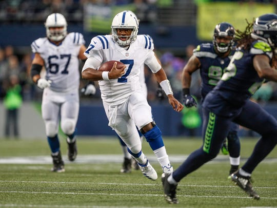 Indianapolis Colts quarterback Jacoby Brissett (7) scrambles for a long gain against the Seattle Seahawks at CenturyLink Field in Seattle on Sunday, Oct. 1, 2017.