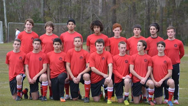 Owen senior Ty Lenk (back row, fourth from left) has committed to play college soccer for New Rochelle (N.Y.).