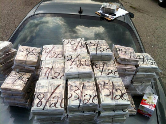 Among the evidence presented against former Detroit police officers Bryan Watson and David Hansberry was this photo of cocaine money found stashed in a truck. Prosecutors allege the police found $3.3 million but only $1.1 million was turned into the evidence room.