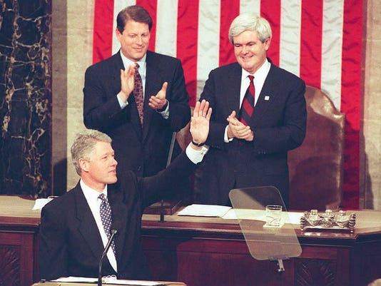 US President Bill Clinton waves to members of Cong