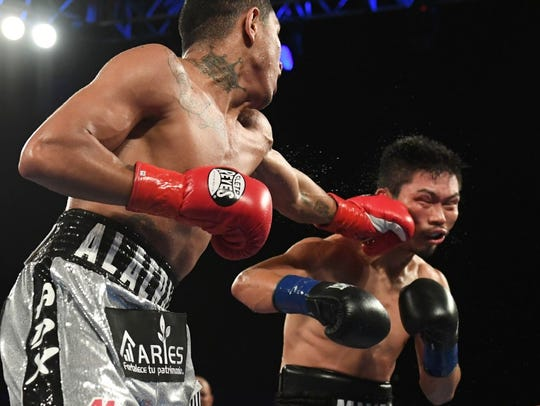 Miguel Berchelt, left, catches Takashi Miura with a left during a fight earlier in his career.