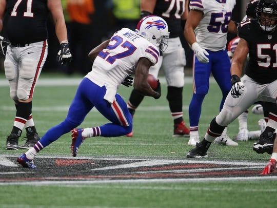 Buffalo Bills cornerback Tre'Davious White (27) picks