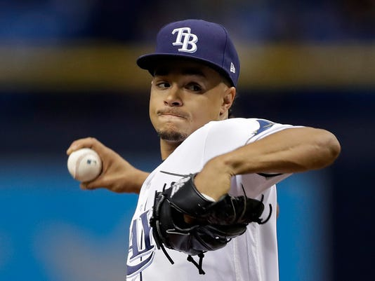 Tampa Bay Rays starting pitcher Chris Archer goes into his windup against the Toronto Blue Jays during the first inning of a baseball game Friday, May 5, 2017, in St. Petersburg, Fla. (AP Photo/Chris O'Meara)