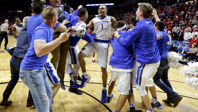IPFW guard Bryson Scott (1) celebrates a 71-68 win over Indiana in overtime in an NCAA college basketball game in Fort Wayne, Ind., Tuesday, Nov. 22, 2016. (AP Photo/Michael Conroy)