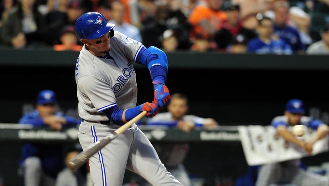 Troy Tulowitzki hits a two-run double in the third inning.