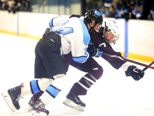 Suffern's Harrison Dganski (24) and Scarsdale's Jack