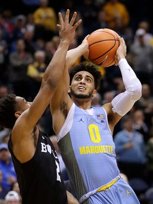 Marquette guard Markus Howard is fouled by Butler guard Aaron Thompson.
