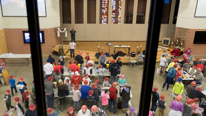 More than 250 people gathered as Concord United Methodist Church observed Martin Luther King Jr. Day by filling thousands of 13.58-ounce plastic bags for the Raleigh, N.C.-based nonprofit Rise Against Hunger on Monday, January 15, 2018. Each bag is filled with soy flour, rice, dehydrated vegetables and a pack of vitamins and minerals to be distributed to Third World countries on every continent but Antarctica.