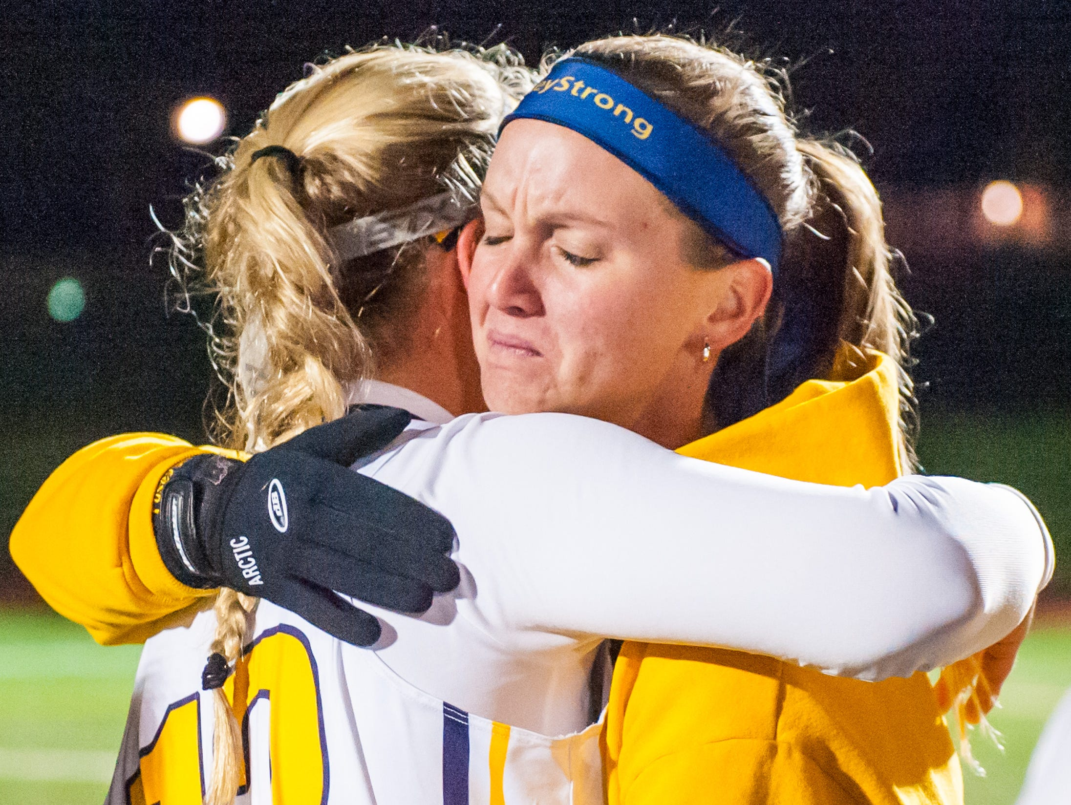 Pocomoke attack Lexi Butler (12) and head coach Brandi Castaneda embrace after winning the MPSSSAA 1A State Finals on Saturday evening at Washington College in Chestertown