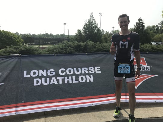 Chris Mosier poses at the long course duathlon championships