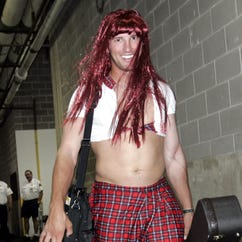 In this Sept. 11, 2005 file photo, dressed as a schoolgirl