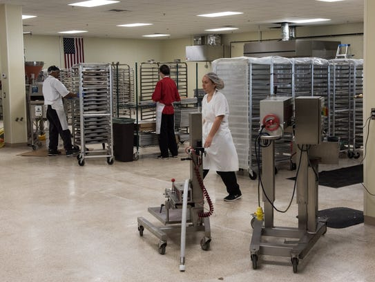 Employees of the Smith Island Baking Company work to