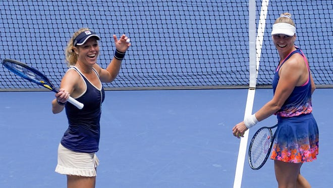 Laura Siegemund, left, and her partner Vera Zvonareva celebrate winning the women's doubles final at the U.S. Open.