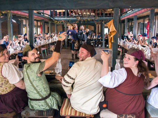 Feast-goers toast to their merry hosts at the Minnesota Renaissance Festival.