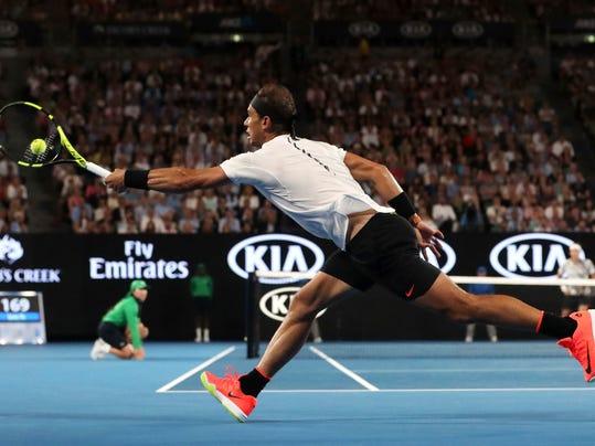 Spain's Rafael Nadal makes a forehand return to Switzerland's Roger Federer in the men's singles final at the Australian Open tennis championships in Melbourne, Australia, Sunday, Jan. 29, 2017. (Scott Barbour/Pool via AP)