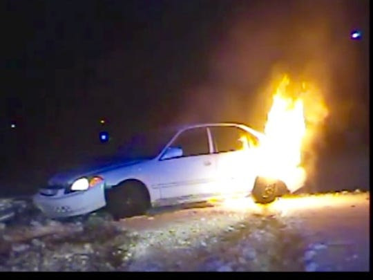 A stolen Honda Civic burns in Ashwaubenon early Friday after it was involved in a police pursuit triggered by a robbery in Bellevue.