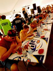 A gizzard eating contest in the Gizzard festival beer