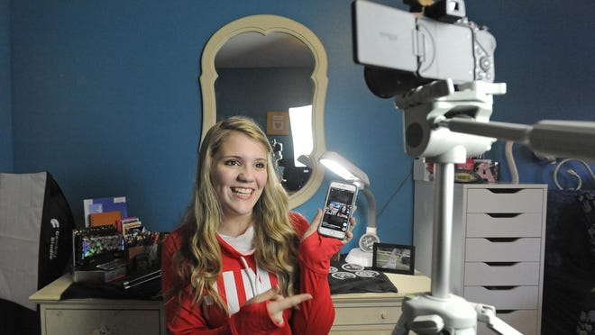 Aliyah Burke demonstrates how she makes a YouTube video at her home in Sioux Falls.