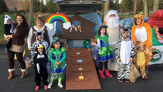 Children and adults take part in last year's Trunk 'n Treat Halloween event at The Bridge in Big Flats.