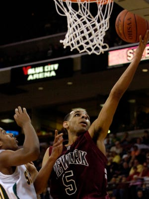 Newark's Greg Avery goes to the basket and scores against Lakewood St. Edward during the Wildcats 2008 state championship game victory. Avery pumped in 33 points.
