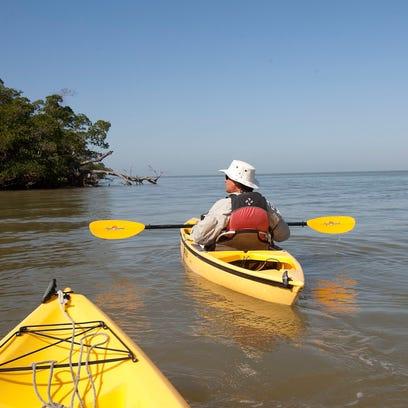 Everglades Area Tours captain Bruce Hitchcock takes