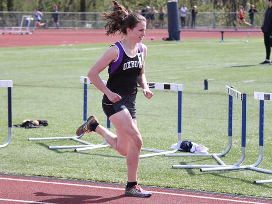 Oxbow's Izzy Giesing heads down the home stretch during the 800 meter race at the Burlington Invitational earlier this month.