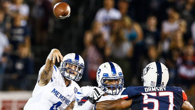 Memphis quarterback Riley Ferguson passes  over the Connecticut defense during the second quarter Oct. 6, 2017.