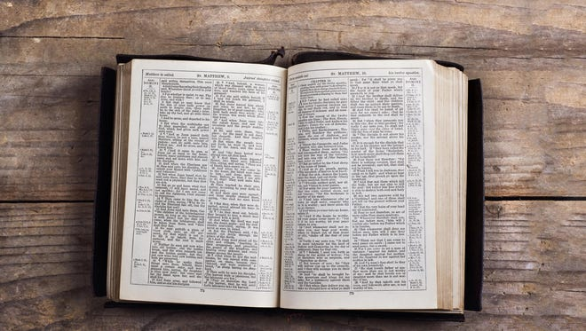 The Bible on a wooden desk