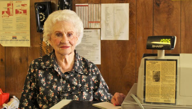 Margaret Blanek, owner of the Dun Bar Restaurant, stands at the cash register next to an obituary of her husband, Jody, who began running the restaurant in 1959. Margaret will turn 90 on March 10.