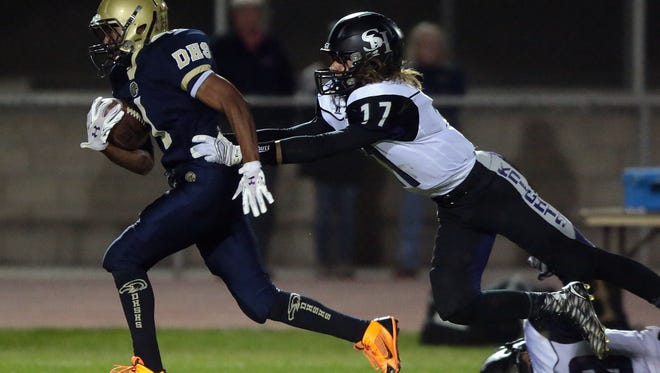 Desert Hot Springs's Solomon Patrick carries the ball for a 1st down against Shadow Hills in the 1st quarter on Friday in Desert Hot Springs.