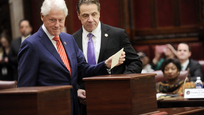 Former President Bill Clinton, left, and Gov. Andrew Cuomo vote  Monday in the state Senate Chamber as part of New York state's Electoral College.