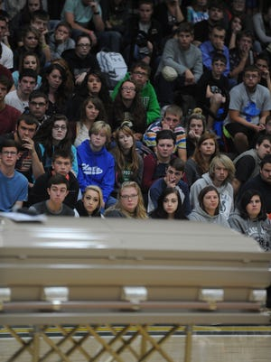 A coffin was rolled into the Northeastern High School gymnasium at the beginning of a program about drug addiction Tuesday.