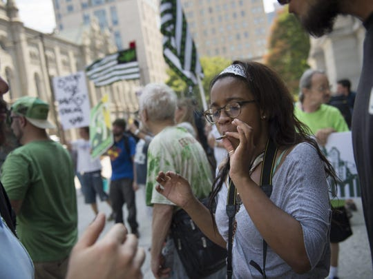 05440593.jpg epa05440593 A demonstrator smokes marijuana in support of the drug's legalization at City Hall, on the first day of the Democratic National Convention, held at the Wells Fargo Center in Philadelphia, Pennsylvania, USA, 25 July 2016. The four-day convention is expected to end with Hillary Clinton formally accepting the nomination of the Democratic Party as their presidential candidate in the 2016 election. EPA/TRACIE VAN AUKEN