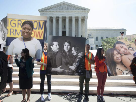 MICHAEL REYNOLDS, European PressPhoto Agency Immigration supporters hold pictures of people affected by government programs at a rally outside the Supreme Court as justices heard arguments in the case of United States v. Texas. epa05265733 Immigration supporters hold up pictures of people affected by DAPA an DACA at a rally outside the Supreme Court as Justices hear oral arguments in the case of United States v. Texas, which will consider a legal challenge to the Deferred Action for Parents of Americans (DAPA) program and the expansion of the Deferred Action for Childhood Arrivals (DACA) program, in Washington, DC, USA, 18 April 2016. Over a thousand immigration supporters attended the rally outside the Supreme Court to show support for DAPA and DACA. EPA/MICHAEL REYNOLDS ORG XMIT: MHR05