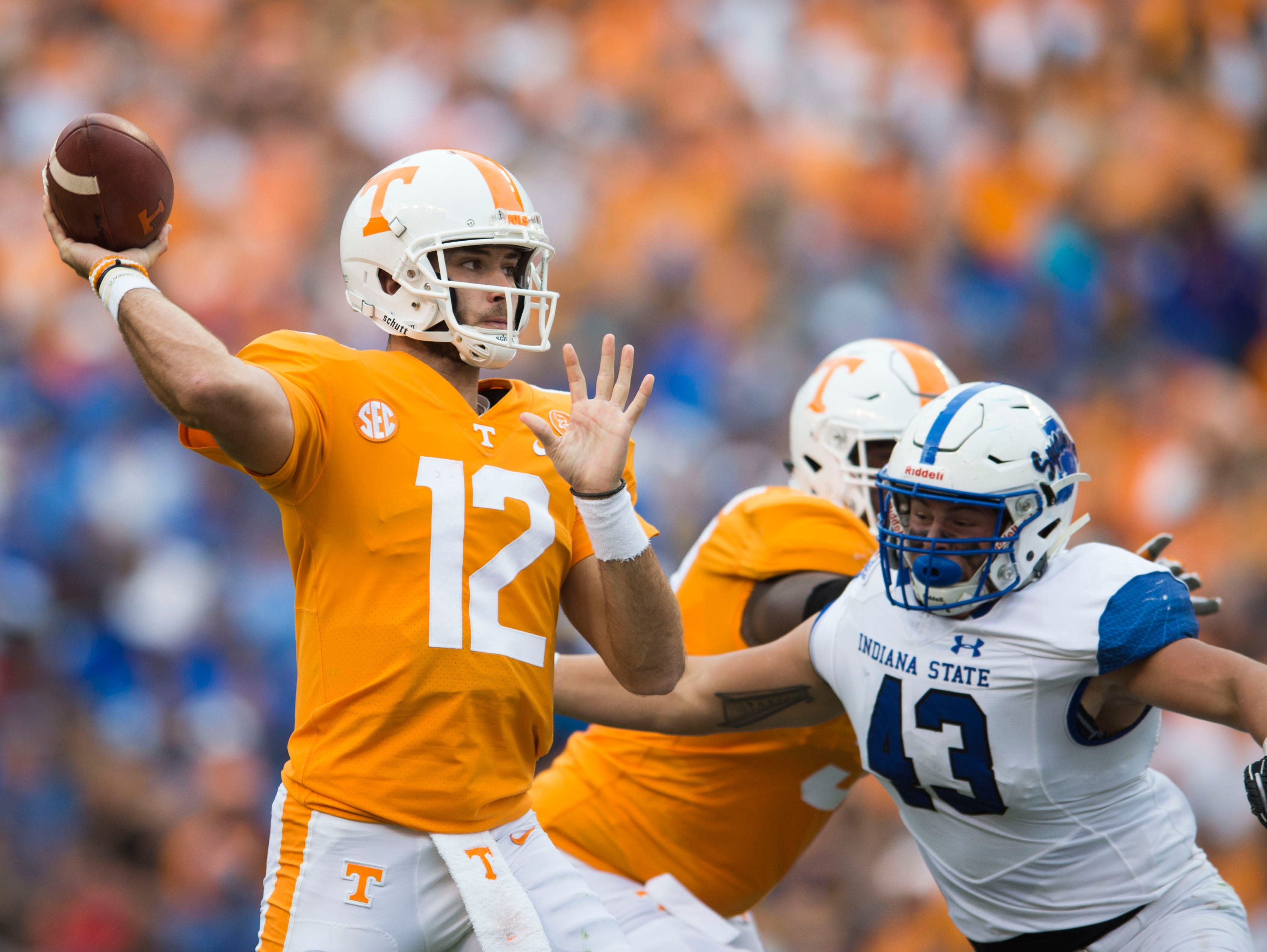 Tennessee quarterback Quinten Dormady (12) prepares to throw a ball as Indiana State linebacker Raymone Clifford (43) attempts to sack him during the Tennessee Volunteers vs. Indiana State Sycamores game at Neyland Stadium in Knoxville, Tenn. Saturday, Sept. 9, 2017.