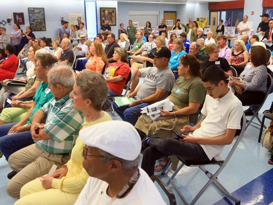 People gather for a town hall meeting Wednesday, April 19, 2017, at the Oveal Williams Senior Center in Corpus Christi. U.S. Rep. Blake Farenthold was not in attendance.