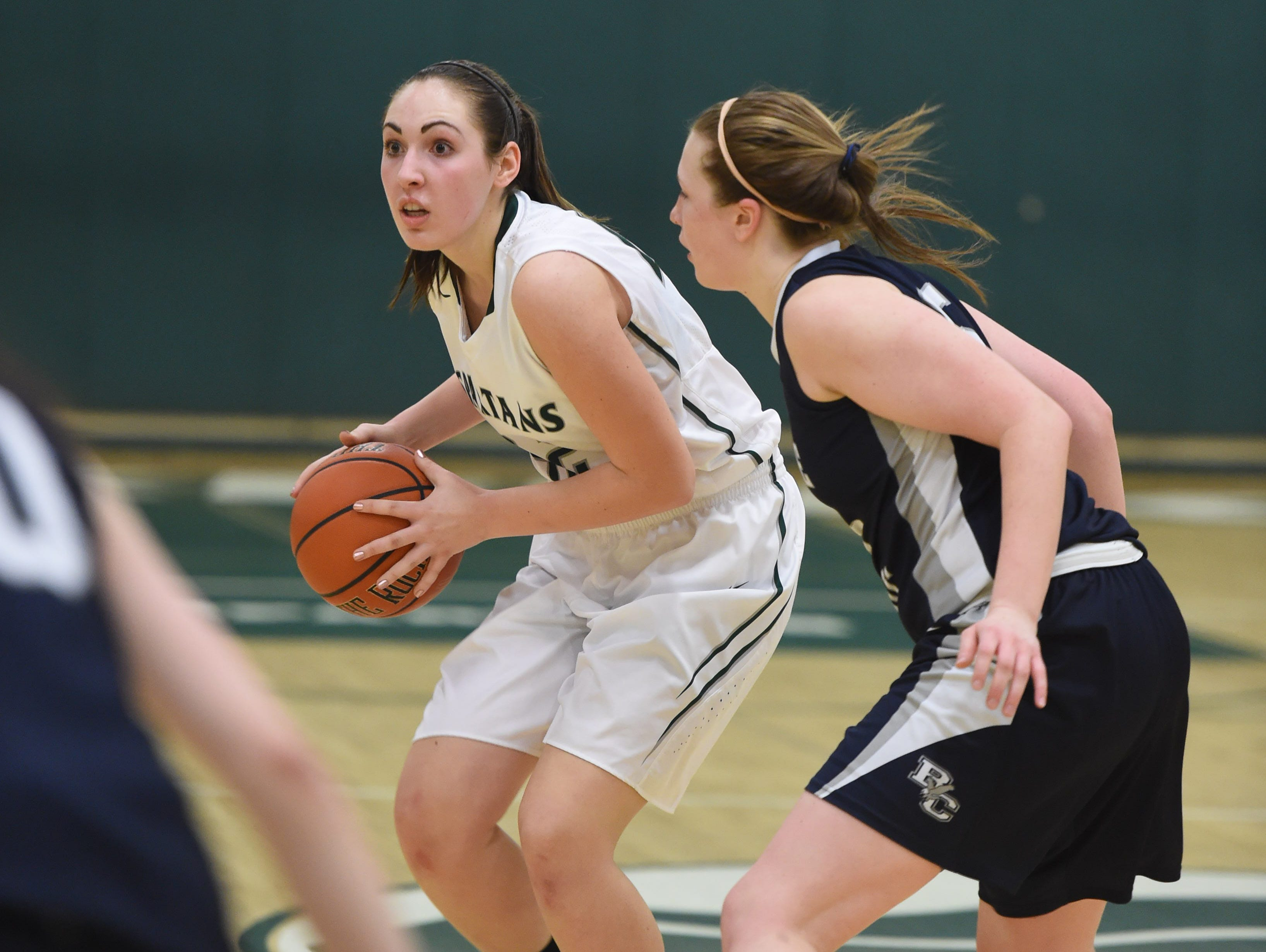 Spackenkill's Noelle Mancini is covered by Burke's Lauren Wapshare during Friday's Section 9 Class B semi-final at Spackenkill.