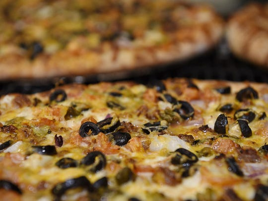 Pizzas come out of the oven Friday at Flying Pig Pizza