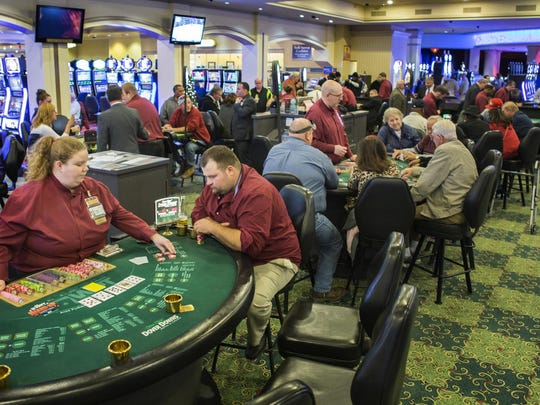 Gamblers play poker at Dover Downs Hotel and Casino on Nov. 15, 2014.