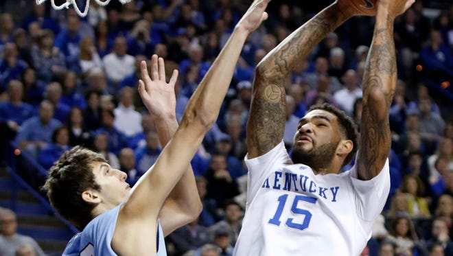 Kentucky's Willie Cauley-Stein (15) shoots under pressure from Columbia's Luke Petrasek during the first half of an NCAA college basketball game, Wednesday, Dec. 10, 2014. (AP Photo/James Crisp)