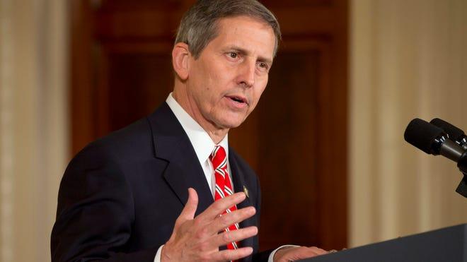 Acting Veterans Affairs Secretary Sloan Gibson speaks in the East Room of the White House in Washington on June 4, 2014.