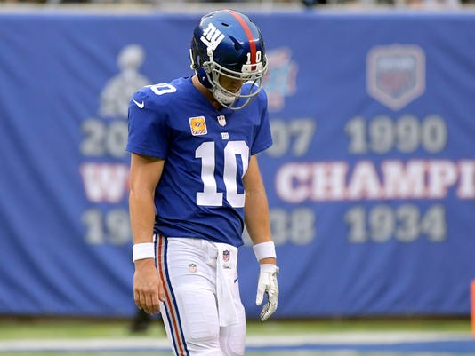 New York Giants quarterback Eli Manning reacts after throwing an interception to the Los Angeles Chargers during the second half of an NFL football game, Sunday, Oct. 8, 2017, in East Rutherford, N.J. (AP Photo/Bill Kostroun)