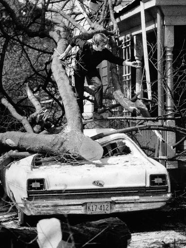 Gary Veteto, 2931 Grinstead, climbing through debris from the tornado.  April 3, 1974
