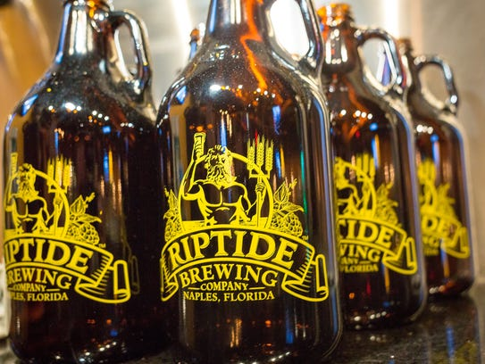 Empty growlers await beer for customers at the Riptide