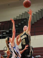 T.L. Hanna senior guard Maggee Bolt shoots over a Woodmont defender Saturday at Westside High School.