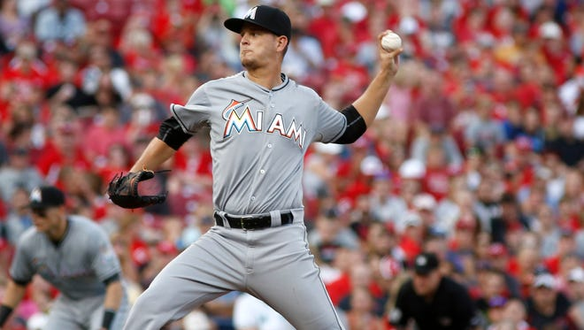 Miami Marlins starting pitcher Justin Nicolino throws against the Cincinnati Reds in the second inning at Great American Ball Park.