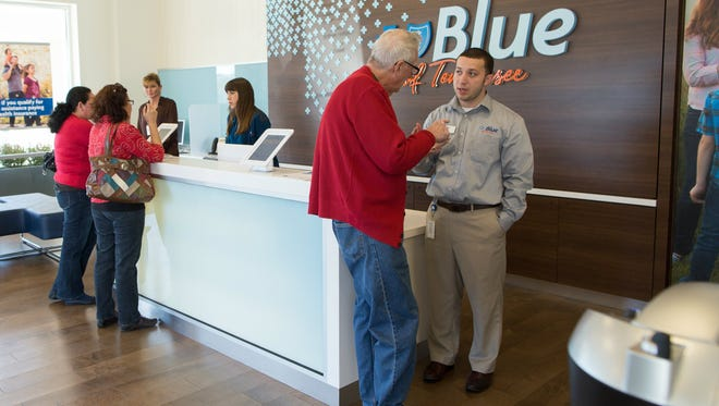 Manager Larry Dix (right) talks with a visitor at the Blue of Tennessee center in Nashville.
