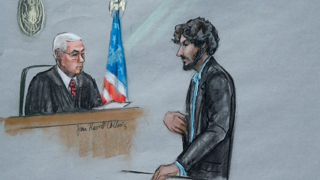 In this June 24, 2015, file courtroom sketch, Boston Marathon bomber Dzhokhar Tsarnaev, right, stands before U.S. District Judge George O'Toole Jr. as he addresses the court during his sentencing, in federal court in Boston.
